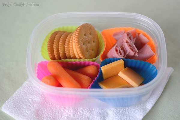 Use old lunchmeat containers and silicone muffin cups to make your own Lunchables | Frugal Family Home